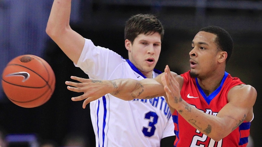 DePaul's Brandon Young (20) passes the ball in front of Creighton's Doug McDermott (3) in the first half of an NCAA college basketball game in Omaha, Neb., Friday, Feb. 7, 2014. (AP Photo/Nati Harnik)