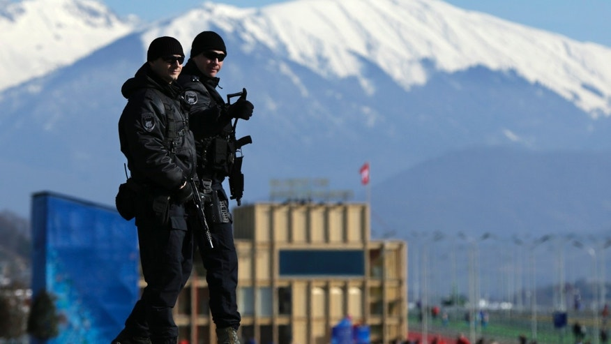 "Feb. 7, 2014 - Heavily-armed Russian military flash a ""thumbs up""  while patrolling Olympic Park prior to opening ceremony at the 2014 Winter Olympics."