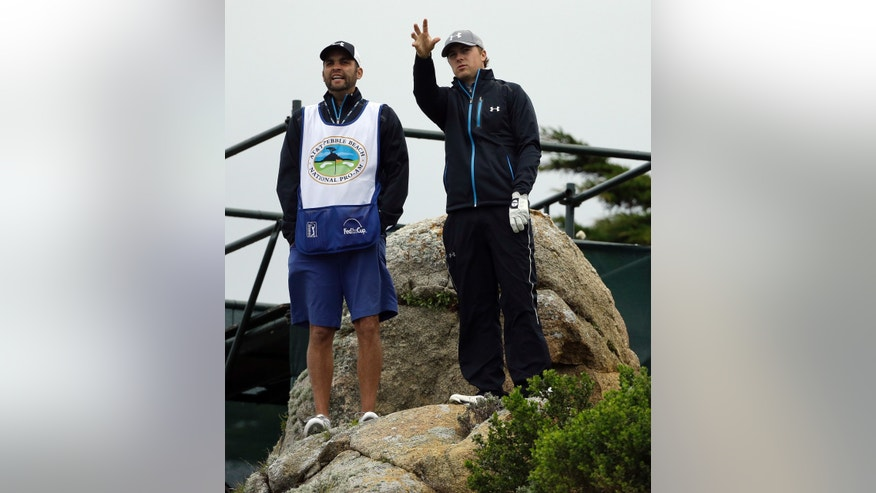 Jordan Spieth, right, gestures beside his caddy, Michael Greller, on the 11th tee Friday, Feb. 7, 2014, during the second round of the AT&T Pebble Beach Pro-Am golf tournament on the Monterey Peninsula Country Club Shore Course in Pebble Beach, Calif. (AP Photo/Ben Margot)
