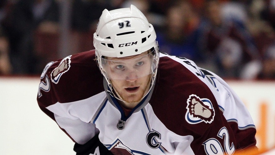 Colorado Avalanche captain Gabriel Landeskog watches the face off during the first period of an NHL hockey game against the Philadelphia Flyers, f 6, 2014, in Philadelphia. (AP Photo/Tom Mihalek)