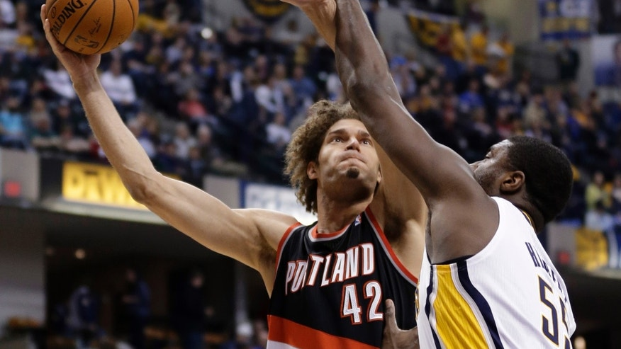 Portland Trail Blazers center Robin Lopez, left, shoots over Indiana Pacers center Roy Hibbert during the first half of an NBA basketball game in Indianapolis, Friday, Feb. 7, 2014.  (AP Photo/Michael Conroy)