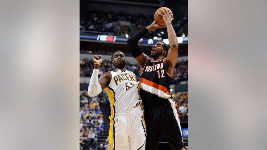 Portland Trail Blazers forward LaMarcus Aldridge, right, shoots over Indiana Pacers center Roy Hibbert during the first half of an NBA basketball game in Indianapolis, Friday, Feb. 7, 2014. (AP Photo/Michael Conroy)