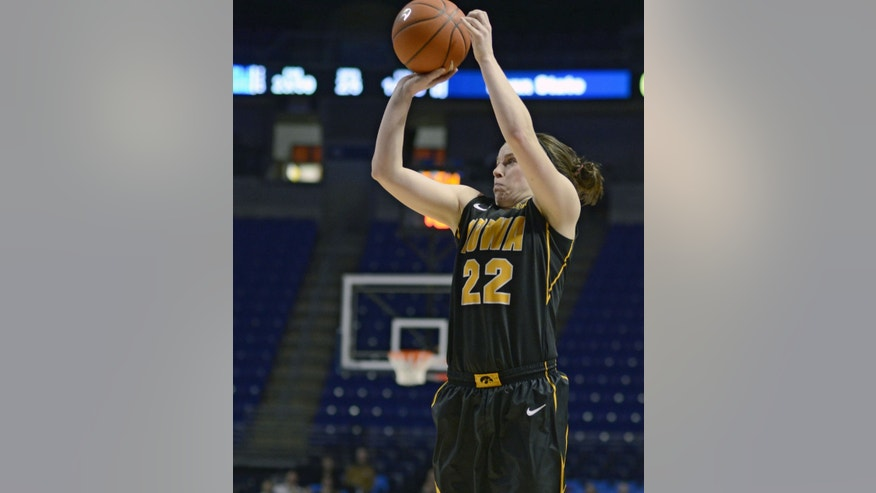 Iowa's Samantha Logic (22) looks to the basket during the second half of an NCAA college basketball game on Thursday, Feb. 6, 2014 in State College, Pa. (AP Photo/Ralph Wilson)