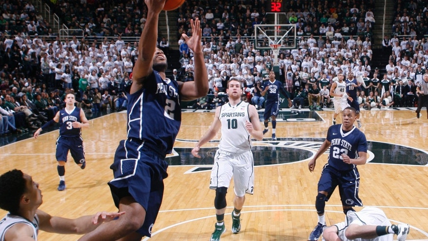 Penn State's D.J. Newbill (2) gets a fast-break layup against Michigan State's Travis Trice, left, Matt Costello (10) and Kenny Kaminski, right, and Penn State's Tim Frazier (23) during the second half of an NCAA college basketball game on Thursday, Feb. 6, 2014, in East Lansing, Mich. Michigan State won 82-67. (AP Photo/Al Goldis)