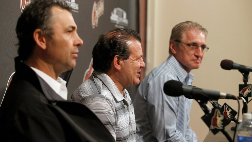 "Members of the gold medal 1980 ""Miracle on Ice"" U.S. hockey team, Neal Broten, left, Mike Eruzione and Buzz Scheider, right, talk to the media prior to being honored at an NHL hockey game between the Chicago Blackhawks and the Phoenix Coyotes, Friday Feb. 7, 2014, in Glendale, Ariz. (AP Photo/Ross D. Franklin)"