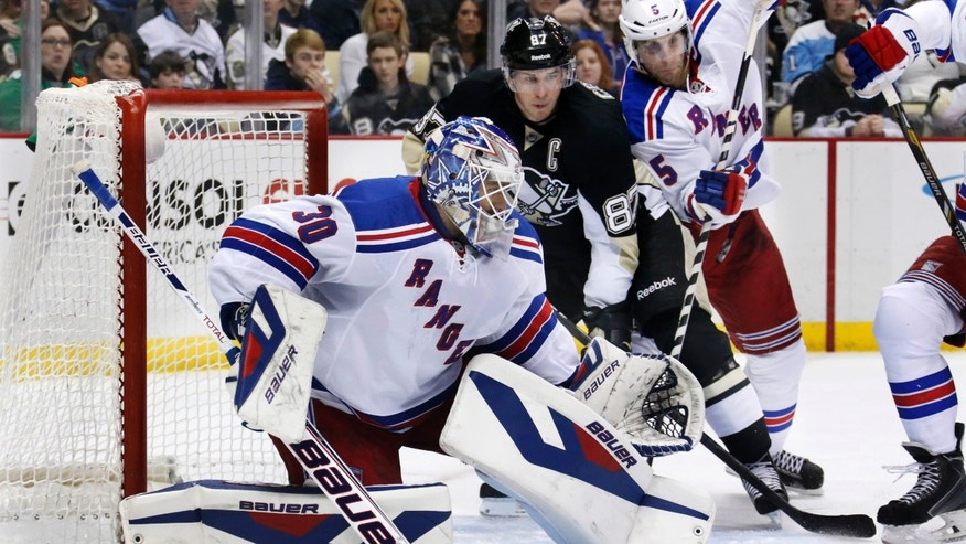 New York Rangers goalie Henrik Lundqvist (30) blocks a shot during the second period of an NHL hockey game as Rangers' Dan Girardi (5) battles Pittsburgh Penguins' Sidney Crosby (87) in Pittsburgh, Friday, Feb. 7, 2014. (AP Photo/Gene J. Puskar)