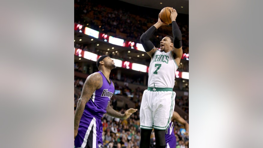 Boston Celtics center Jared Sullinger (7) shoots over Sacramento Kings center DeMarcus Cousins during the first half of an NBA basketball game on Friday, Feb. 7, 2014, in Boston. Sullinger scored 31 points in the Celtics' 99-89 win. (AP Photo/Mary Schwalm)