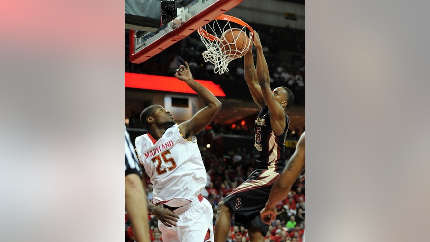 Florida State guard Aaron Thomas, right, dunks against Maryland forward Jonathan Graham, left, during the first half of an NCAA college basketball game, Saturday, Feb. 8, 2014, in College Park, Md. (AP Photo/Nick Wass)