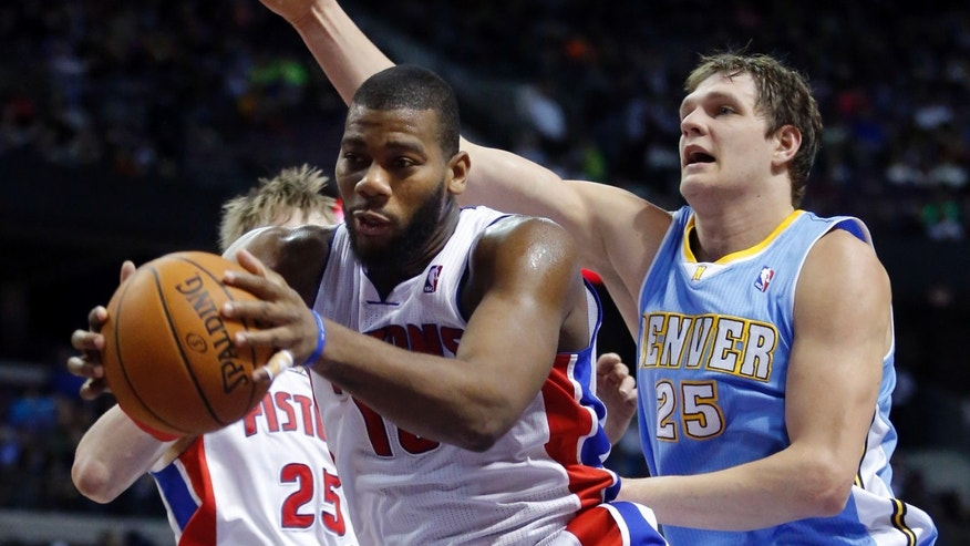 Detroit Pistons center Greg Monroe, front left, grabs a rebound in front of Denver Nuggets center Timofey Mozgov (25) during the first half of an NBA basketball game on Saturday, Feb. 8, 2014, in Auburn Hills, Mich. (AP Photo/Duane Burleson)
