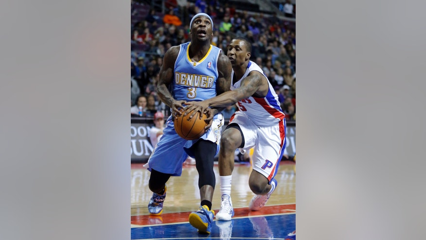 Detroit Pistons guard Kentavious Caldwell-Pope (5) knocks the ball away from Denver Nuggets guard Ty Lawson (3) during the first half of an NBA basketball game on Saturday, Feb. 8, 2014, in Auburn Hills, Mich. (AP Photo/Duane Burleson)
