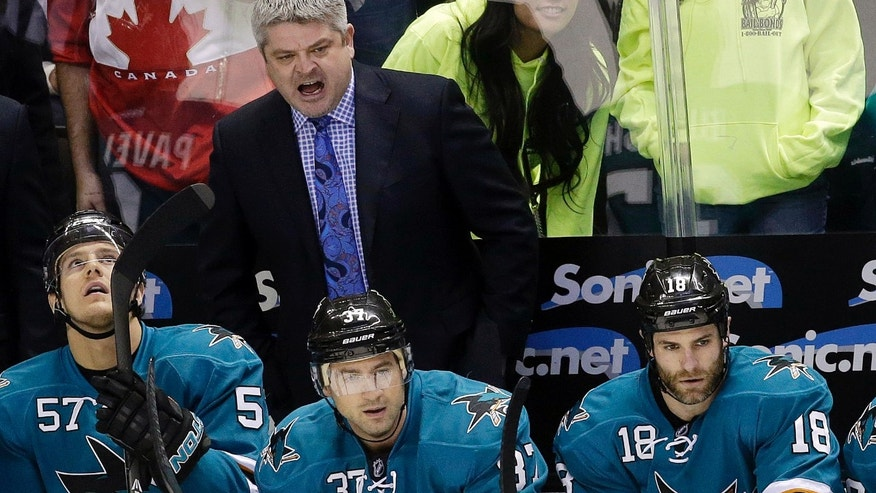 San Jose Sharks head coach Todd McLellan yells instructions from the bench during the first period of the Sharks' NHL hockey game against the Columbus Blue Jackets on Friday, Feb. 7, 2014, in San Jose, Calif. (AP Photo/Marcio Jose Sanchez)