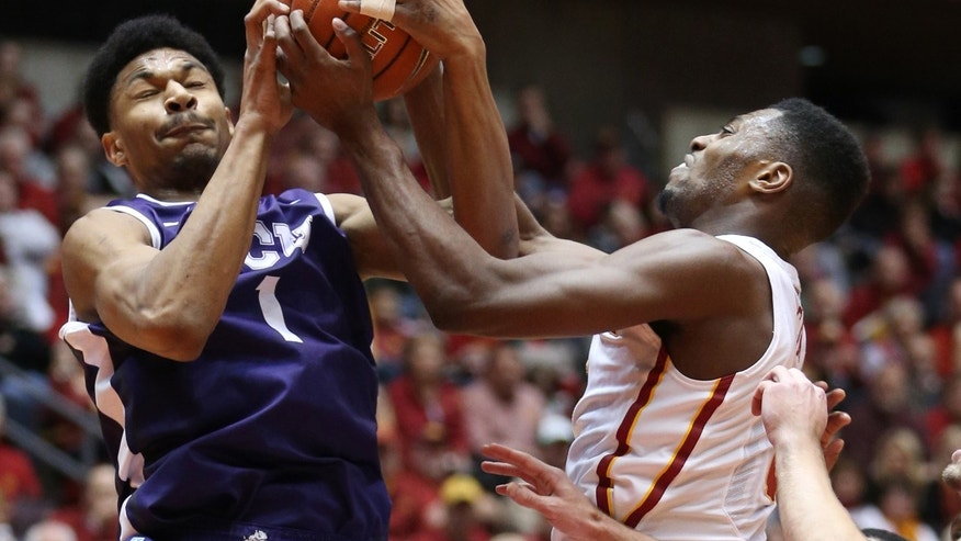 TCU center Karviar Shepherd (1) and Iowa State forward Melvin Ejim (3) vie for control of a rebound during the first half of an NCAA college basketball game at Hilton Coliseum in Ames, Iowa, Saturday, Feb. 8, 2014. (AP Photo/Justin Hayworth)