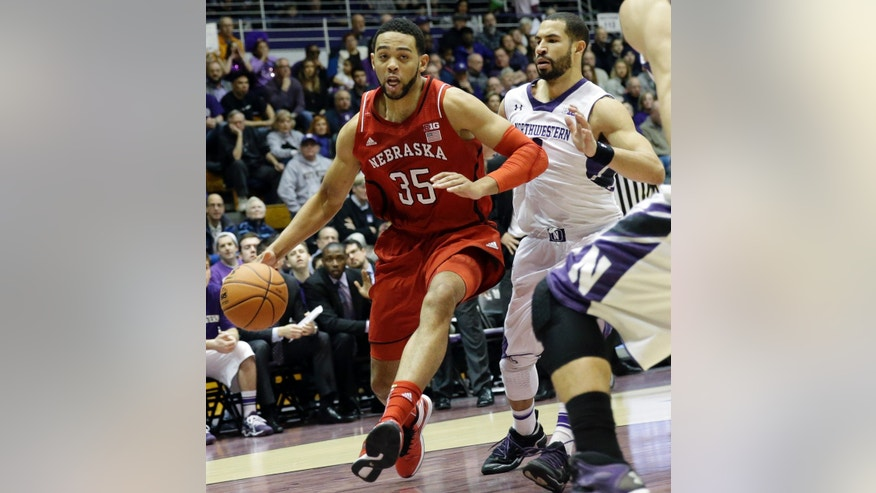 Nebraska forward Walter Pitchford (35) drives to the basket as Northwestern guard Drew Crawford guards during the first half of an NCAA college basketball game in Evanston, Ill., on Saturday, Feb.8, 2014. (AP Photo/Nam Y. Huh)