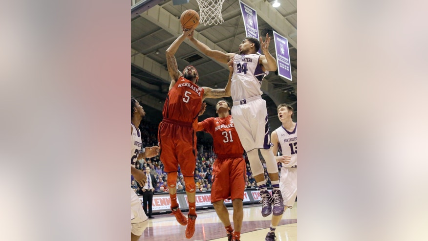 Nebraska guard Terran Petteway (5) shoots against Northwestern guard Sanjay Lumpkin (34) during the first half of an NCAA college basketball game in Evanston, Ill., Saturday, Feb. 8, 2014. (AP Photo/Nam Y. Huh)