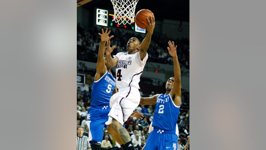 Mississippi State guard Trivante Bloodman (4) attempts a layup between Kentucky guards Andrew Harrison (5) and Aaron Harrison (2) in the first half of an NCAA college basketball game in Starkville, Miss., Saturday, Feb. 8, 2014. (AP Photo/Rogelio V. Solis)
