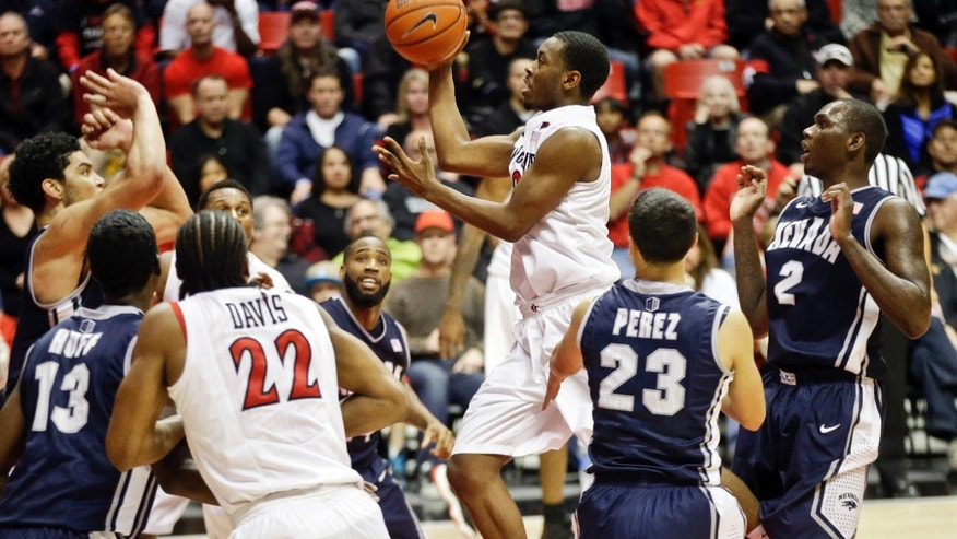 San Diego State Aztecs' Xavier Thames splits the entire Nevada defense while driving for a basket during the first half of an NCAA college basketball game Saturday, Feb. 8, 2014, in San Diego. (AP Photo/Lenny Ignelzi)