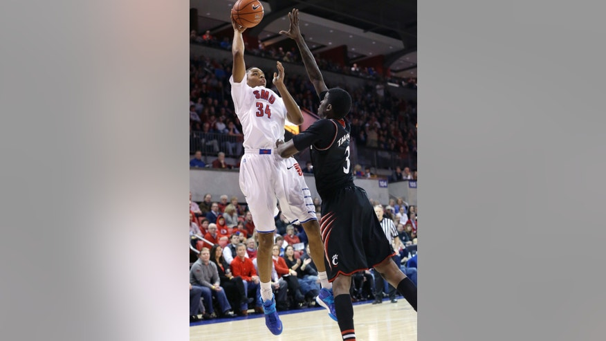SMU forward Ben Moore (34) shoots against Cincinnati forward Shaquille Thomas (3) during the first half of an NCAA college basketball game Saturday, Feb. 8, 2014, in Dallas. (AP Photo/LM Otero)  vcb