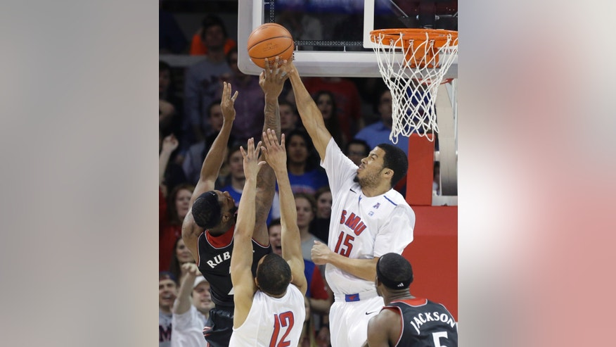 SMU center Cannen Cunningham (15) blocks a shot by Cincinnati forward Titus Rubles (2) during the first half of an NCAA college basketball game Saturday, Feb. 8, 2014, in Dallas. (AP Photo/LM Otero)
