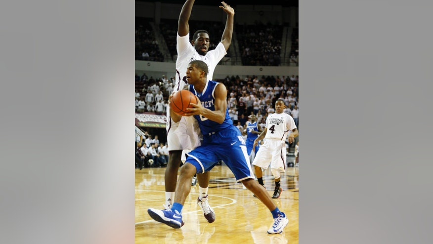 Kentucky guard Aaron Harrison (2) tries to push past the defense of Mississippi State forward Gavin Ware (20) in the second half of an NCAA college basketball game in Starkville, Miss., Saturday, Feb. 8, 2014. Kentucky won 69-59. (AP Photo/Rogelio V. Solis)