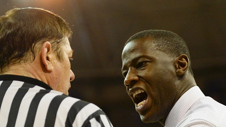 Alabama coach Anthony Grant, right,  has words with referee Mike Thibodeaux, left, during the second half of an NCAA college basketball game against Florida Saturday, Feb. 8, 2014 in Gainesville, Fla. Florida 78-69. (AP Photo/Phil Sandlin)
