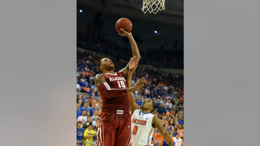 Alabama forward Nick Jacobs (15) shoots over Florida's Kasey Hill (0) during the second half of an NCAA college basketball game Saturday, Feb. 8, 2014 in Gainesville, Fla. Florida won 78-69. (AP Photo/Phil Sandlin)