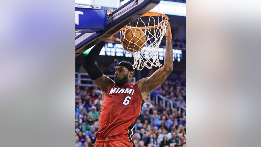 Miami Heat's LeBron James (6) dunks against the Utah Jazz in the second quarter of an NBA basketball game Saturday, Feb. 8, 2014, in Salt Lake City. (AP Photo/Rick Bowmer)