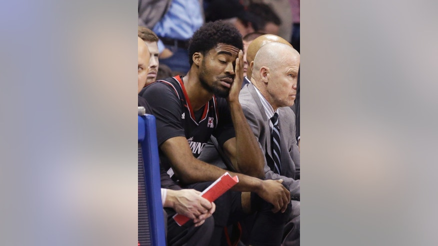 Cincinnati guard Ge'Lawn Guyn (14) reacts after he was benched in the second half of the an NCAA college basketball game against SMU on Saturday, Feb. 8, 2014, in Dallas. SMU won 76-55. (AP Photo/LM Otero)