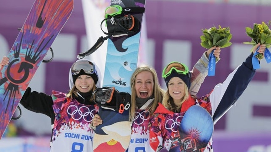 February 9, 2014: Jamie Anderson of the United States, center, celebrates with silver medalist Enni Rukajarvi of Finland, left, and bronze medalist Jenny Jones of Britain, after Anderson won the women's snowboard slopestyle final at the 2014 Winter Olympics in Krasnaya Polyana, Russia. (AP Photo/Andy Wong)
