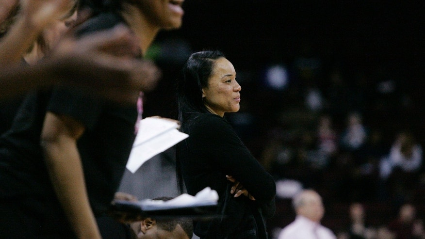 South Carolina Dawn Staley looks on as her team rack up the points during the second half of their NCAA college basketball game against Arkansas, Sunday Feb. 9, 2014, in Columbia, SC. South Carolina defeated 67-49. (AP Photo/Mary Ann Chastain)