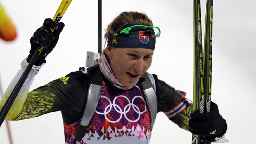 Feb. 9, 2014: Slovakia&#39&#x3b;s Anastasiya Kuzmina smiles after completing the women&#39&#x3b;s biathlon 7.5k sprint, at the 2014 Winter Olympics in Krasnaya Polyana, Russia.