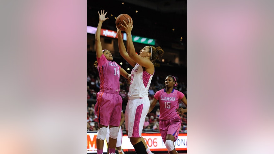 Maryland's Malina Howard, front right, shoots as Clemson's Paige Mosely (14) defends in the second half of an NCAA college basketball game on Sunday, Feb. 9, 2014, in College Park, Md. Maryland won 95-43. (AP Photo/Gail Burton)