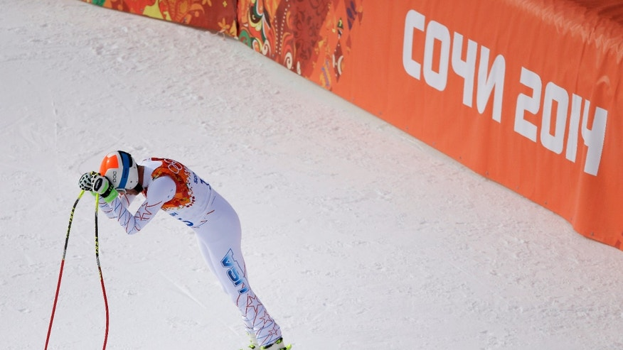 United States' Bode Miller reacts after his run in the men's downhill event at the 2014 Winter Olympics, Sunday, Feb. 9, 2014, in Krasnaya Polyana, Russia. (AP Photo/Charlie Riedel)