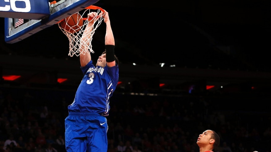 Creighton's Doug McDermott (3) goes to the basket against St. John's during the first half of an NCAA college basketball game, Sunday, Feb. 9, 2014, in New York. (AP Photo/Jason DeCrow)