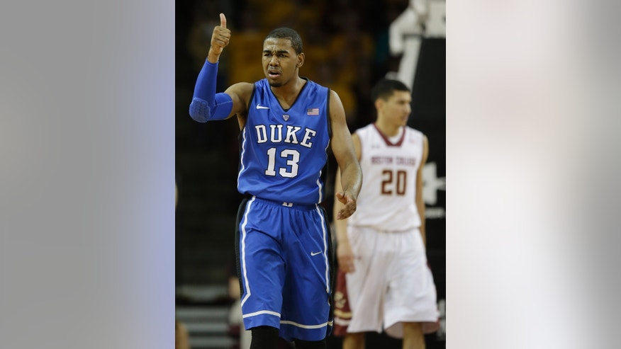 Duke guard Matt Jones (13) give a thumbs-up to his bench after scoring during the first half of their NCAA college basketball game against Boston College on the Boston College campus in Boston, Saturday, Feb. 8, 2014. (AP Photo/Stephan Savoia)