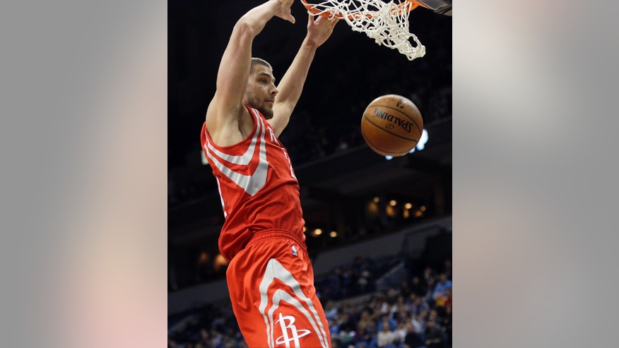 Houston Rockets' Chandler Parsons dunks in the second half of an NBA basketball game against the Minnesota Timberwolves, Monday, Feb. 10, 2014, in Minneapolis. Parsons led the Rockets with 20 points in their 107-89 win. (AP Photo/Jim Mone)