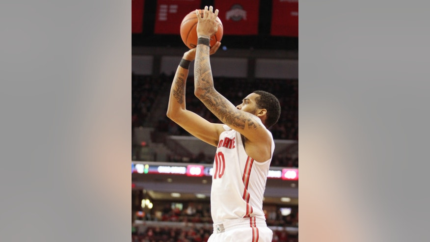 Ohio State's LaQuinton Ross (10) shoots a three against Purdue during the second half of an NCAA college basketball game Saturday, Feb. 8, 2014, in Columbus, Ohio. Ohio State won 67-49. Ross had 17 points. (AP Photo/Mike Munden)