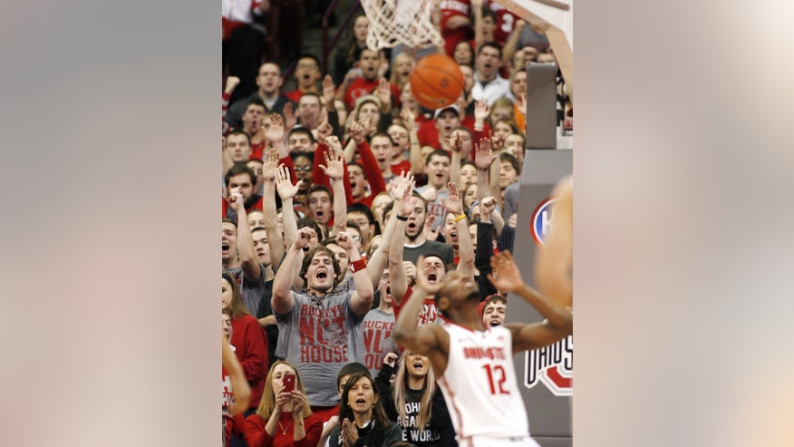 Ohio State fans cheer as Sam Thompson (12) dunks against Purdue during the first half of an NCAA college basketball game Saturday, Feb. 8, 2014, in Columbus, Ohio. (AP Photo/Mike Munden)