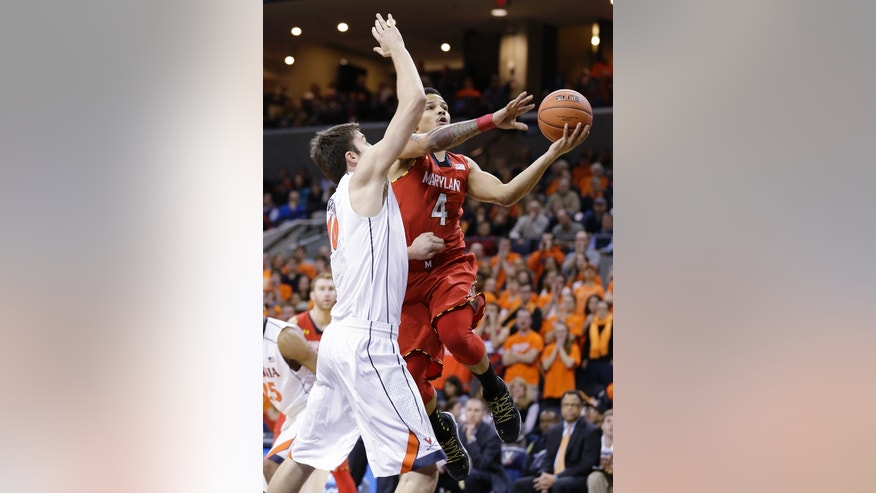 Maryland guard Seth Allen (4) takes a shot over Virginia forward/center Mike Tobey (10) during the first half of an NCAA college basketball game in Charlottesville, Va., Monday, Feb. 10, 2014. (AP Photo/Steve Helber)