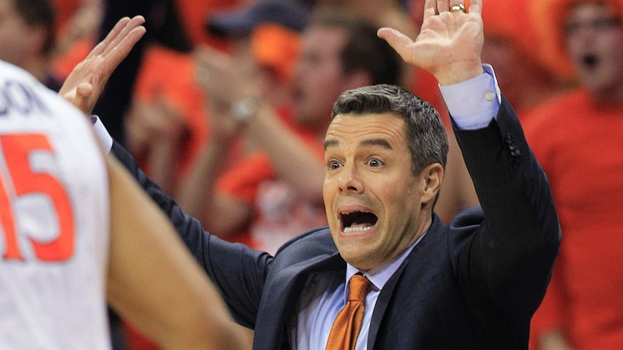 Virginia head coach Tony Bennett directs his team during the first half of an NCAA college basketball game in Charlottesville, Va., Monday, Feb. 10, 2014. (AP Photo/Steve Helber)