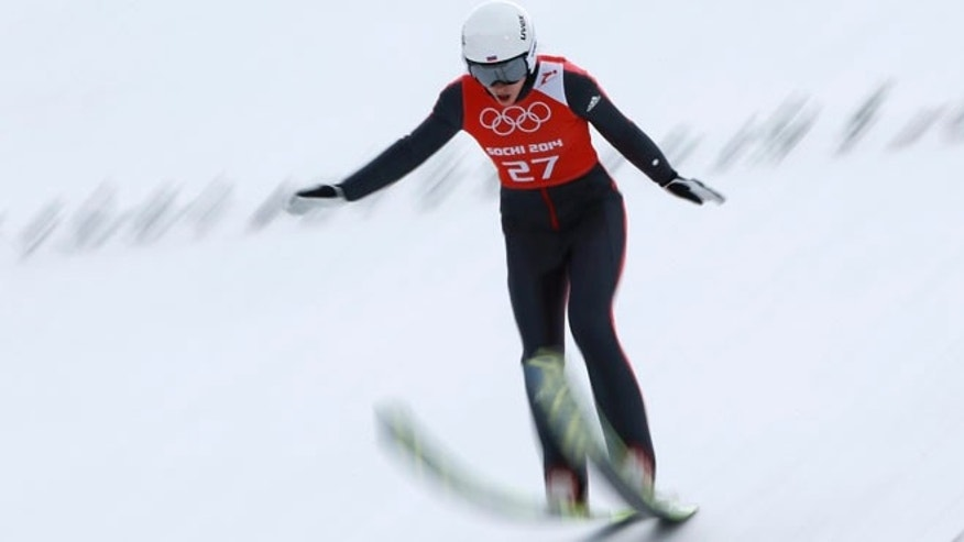 Feb. 9, 2014: Russia's Irina Avvakumova lands during a women's normal hill individual training session at the 2014 Winter Olympics in Krasnaya Polyana, Russia.