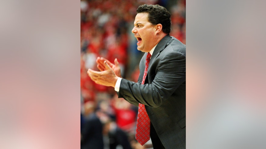 Arizona's head coach Sean Miller encourages his team in the second half against Oregon State of an NCAA college basketball game on Sunday, Feb. 9, 2014, in Tucson, Ariz. Arizona won 76-54. (AP Photo/John MIller)