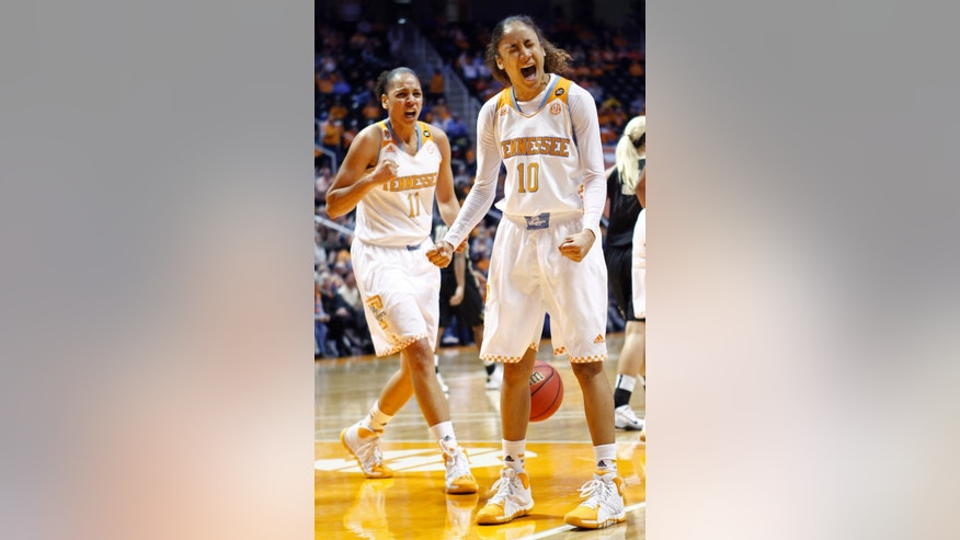 Tennessee guard Meighan Simmons (10) and Cierra Burdick (11) react to a play in the second half of an NCAA college basketball game against Vanderbilt, Monday, Feb. 10, 2014, in Knoxville, Tenn. Tennessee won 81-53. (AP Photo/Wade Payne)