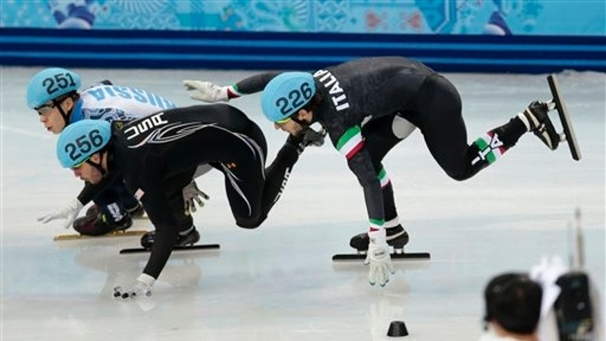 Eduardo Alvarez (left) loses his balance with Yuri Confortola of Italy Monday, Feb. 10, 2014, in Sochi, Russia.