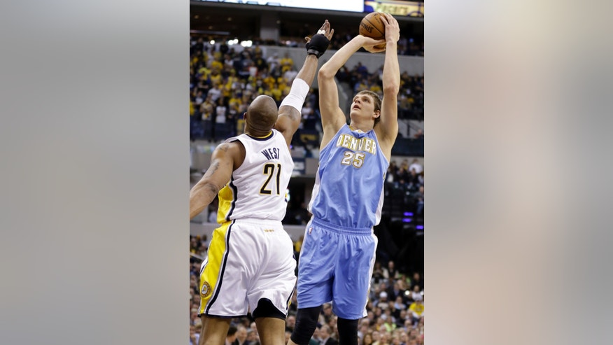 Denver Nuggets center Timofey Mozgov (25) shoots over Indiana Pacers forward David West in the first half of an NBA basketball game in Indianapolis, Monday, Feb. 10, 2014. (AP Photo/Michael Conroy)