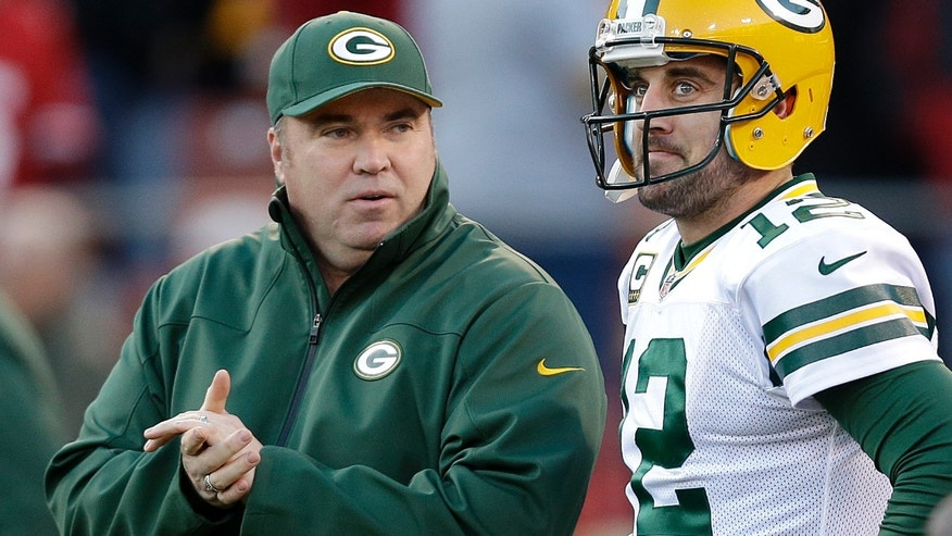 FILE - In this Jan. 12, 2013 file photo, Green Bay Packers head coach Mike McCarthy talks with quarterback Aaron Rodgers (12) before an NFC divisional playoff football game against the San Francisco 49ers in San Francisco. (AP Photo/Marcio Jose Sanchez, File)