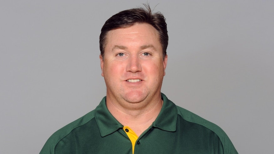 FILe - This is a 2012 file photo showing Green Bay Packers coach Alex Van Pelt.  Van Pelt may have one the toughest and easiest assistant coaching jobs in the NFL. He might be the new quarterbacks coach of the Packers, but in one sense there's only so much wisdom Van Pelt can impart when his top pupil is Aaron Rodgers. (AP Photo/File)