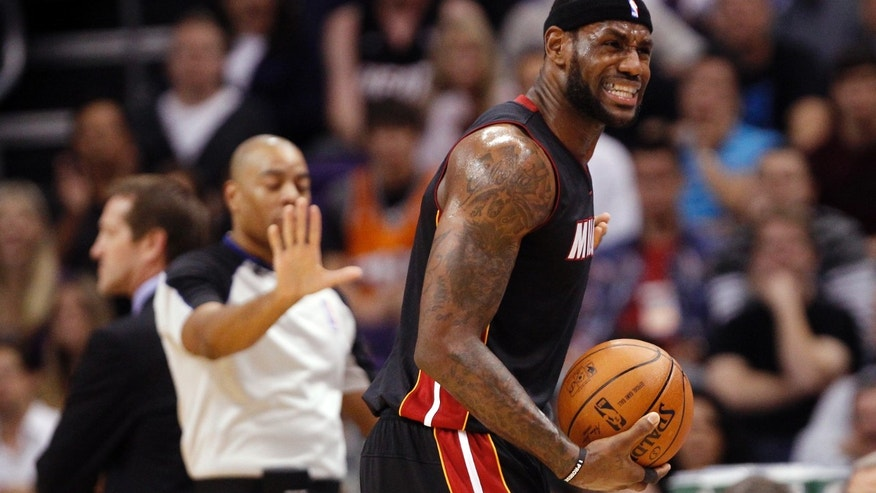 Miami Heat forward LeBron James argues a foul called during the first quarter an NBA basketball game against the Phoenix Suns on Tuesday, Feb. 11, 2014, in Phoenix. (AP Photo/The Arizona Republic, Michael Chow) MAGS OUT  NO SALES  MESA OUT  MARICOPA COUNTY OUT