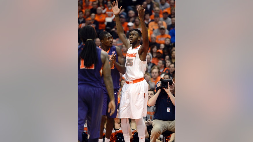 Syracuse's Rakeem Christmas reacts after being called for a fourth foul against Clemson during the second half of an NCAA college basketball game in Syracuse, N.Y., Sunday, Feb. 9, 2014. Syracuse won 57-44. (AP Photo/Kevin Rivoli)