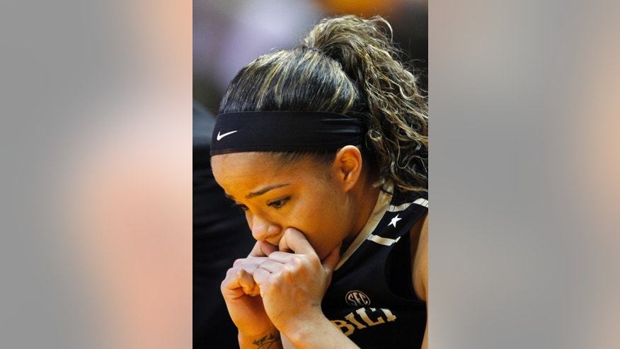 Vanderbilt guard Jasmine Lister sits on the bench in the second half of an NCAA college basketball game against Tennessee, Monday, Feb. 10, 2014, in Knoxville, Tenn. Tennessee won 81-53. (AP Photo/Wade Payne)