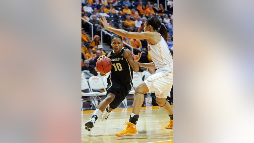 Vanderbilt guard Christina Foggie (10) drives against Tennessee center Isabelle Harrison in the second half of an NCAA college basketball game, Monday, Feb. 10, 2014, in Knoxville, Tenn. Tennessee won 81-53. (AP Photo/Wade Payne)